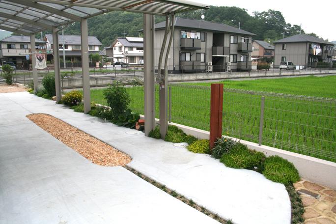 コンクリート土間駐車場 R中抜き加工化粧砂利仕上げ カーポート・駐車場